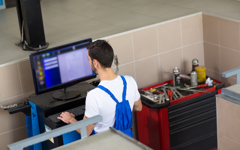 A mechanic studying data from a car diagnostics software