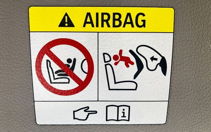 Airbag graphical warning and instructions