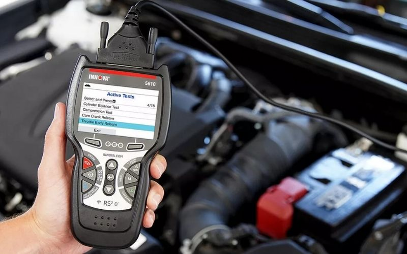 An OBD2 scanner connected to a car ready to scan